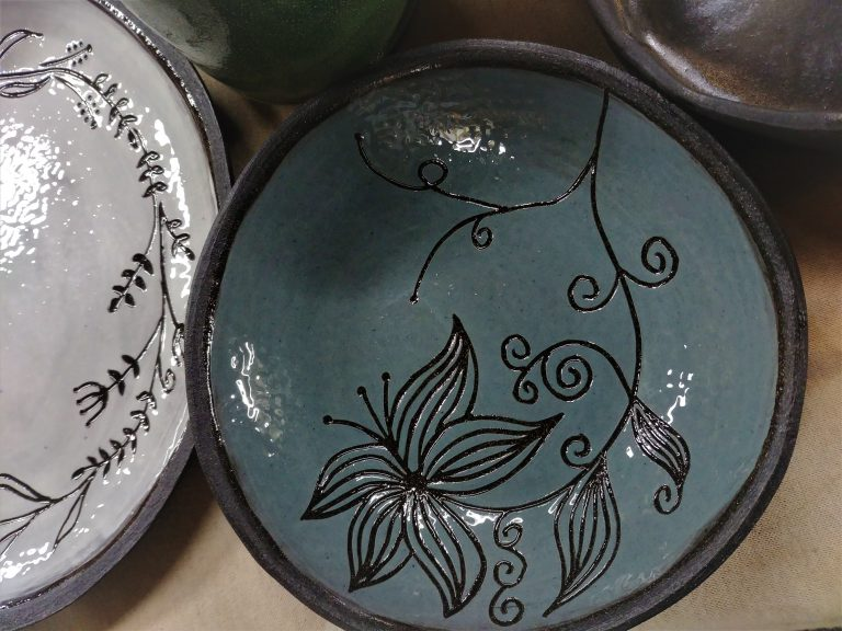 Ceramics, slip carving/scratching, floral design