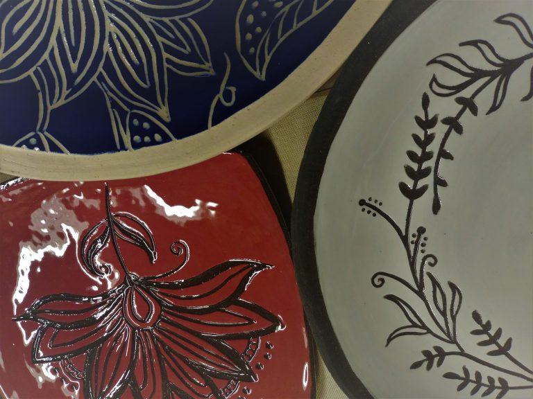 Ceramic plates, slip-carved, transparent glaze