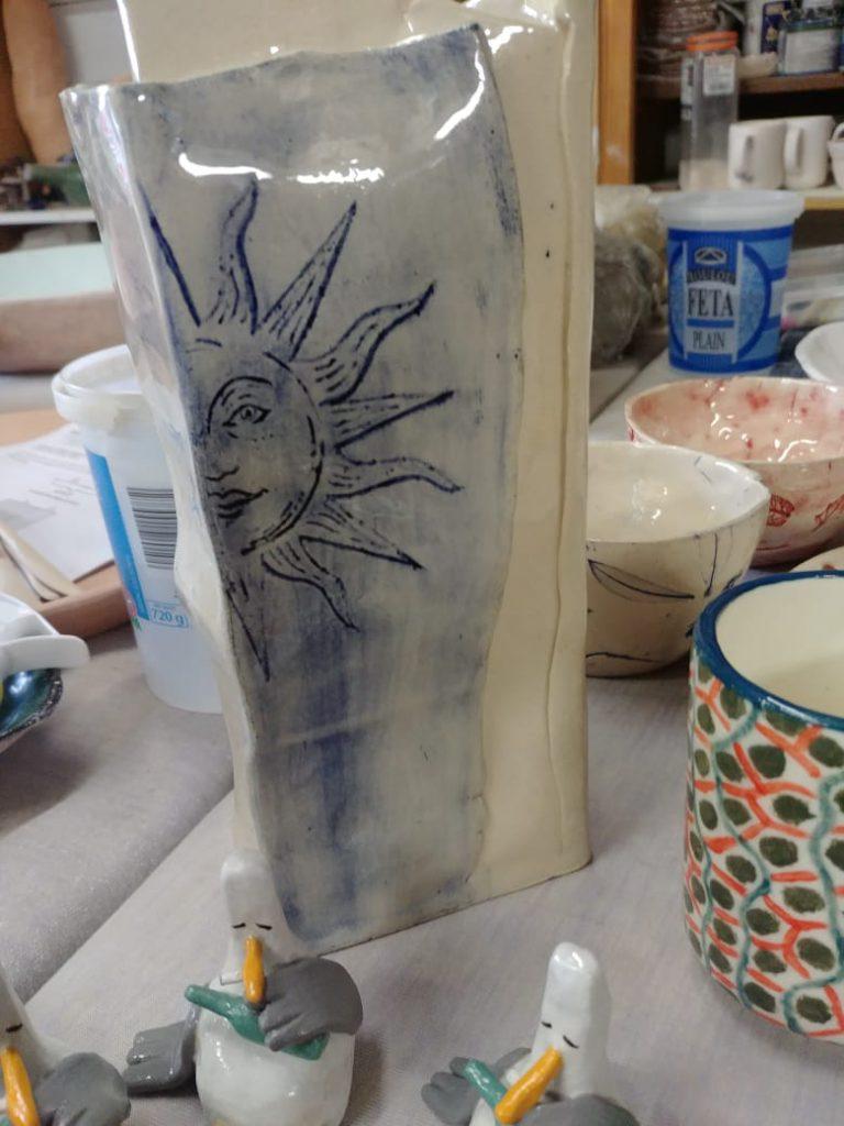 Ceramics, Stoneware, cobalt oxide wash, sun imprint